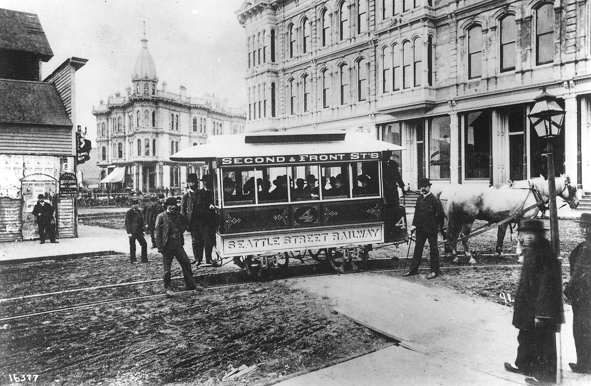 1920px-Seattle_Street_Railway,_the_first_streetcar_in_Seattle,_at_Occidental_Ave_and_Yesler_W...jpeg