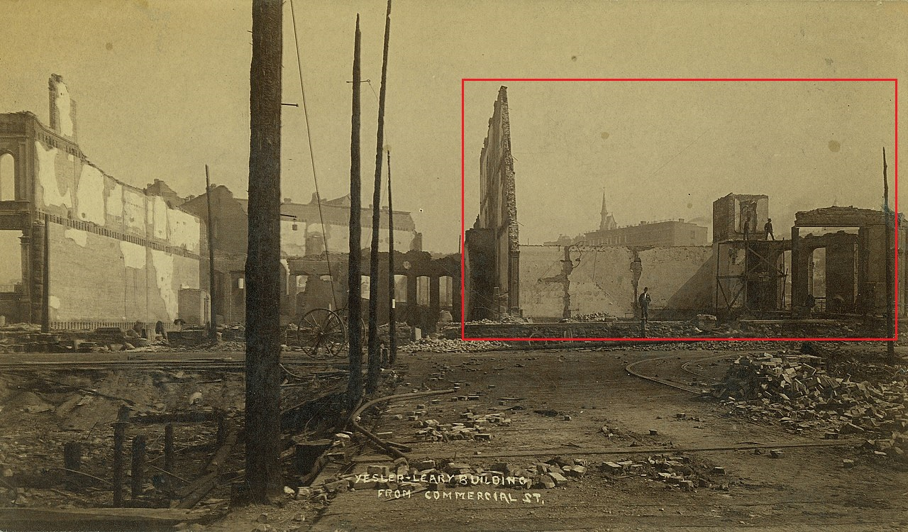 Aftermath_of_the_fire_of_June_6,_1889,_looking_north_on_1st_Ave_S_at_Yesler_toward_the_ruins_o...jpg