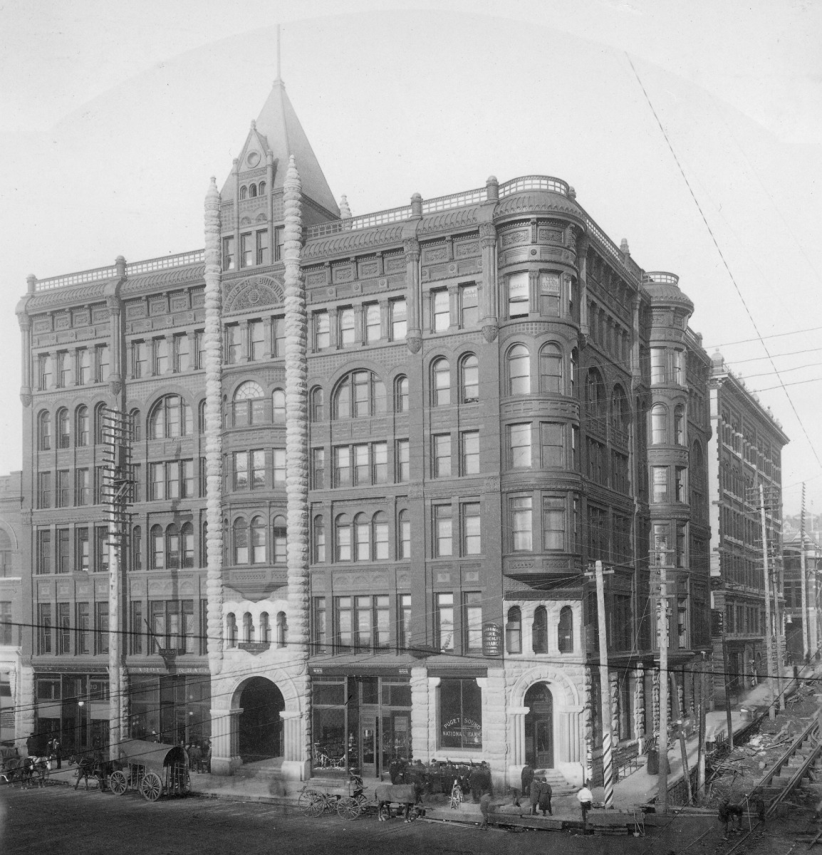 Pioneer_Building,_corner_of_1st_Ave_and_James_St,_Seattle,_Washington,_ca_1890_1.jpg