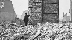 1871 Chicago. A man stands amid the ruins of the Union Depot